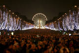 Revellers Celebrate the New Year on the Champs Elysees Avenue in Paris, France Photographic Print by Lucas Dolega