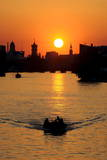 A Boat on the River Spree During Sunset in Berlin, Germany Photographic Print by Gero Breloer