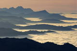 The Sun Sets over the Mountains and the Sea of Fog Photographic Print by Alessandro Della Bella