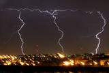 Multiple Bolts of Lightening Strike Jerusalem During an Evening Thunder and Rain Storm Photographic Print by Yossi Zamir