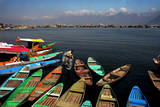 A Kashmiri Man Makes Way for His Boat on the Famous Dal Lake in Srinagar Photographic Print by Altaf Qadri