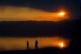 A Couple Walk on a Bridge During Sunset in the Village of Trpejce Photographic Print by Georgi Licovski