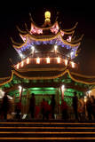 A Pagoda Is Illuminated at Night Beside a Canal in Suzhou, Jiangsu Province, China Photographic Print by Michael Reynolds
