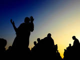 Muslim Pilgrims Pray at the Mount of Mercy (Also Called Mount Arafat) at Sunrise Photographic Print by Alaa Badarneh