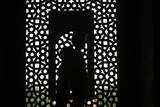 A Couple Stands Inside the Humayun's Tomb, Nizamuddin East, India Photographic Print by Money Sharma