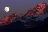 The Moon Rises Above the Western Swiss Alps Photographic Print by Olivier Maire