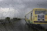 A View of a Bus from a Car During a Brief Rain Shower in New Delhi Photographic Print by Harish Tyagi