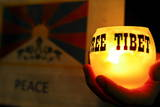 A Member of the Tibetan Community in Japan Holds a Candle, Tokyo Photographic Print by Dai Kurokawa