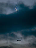 The Crescent of the Moon as an Aircraft Approaches Photographic Print by Frank Rumpenhorst