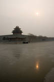 The Pale Winter Sun Is Reflected in the Frozen Moat around the Forbidden City in Beijing, China Photographic Print by Adrian Bradshaw