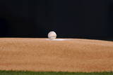 A Baseball Sits on Pitchers Mound Photographic Print by Larry W. Smith