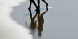 Two Women Walk on La a Beach Photographic Print by Javier Etxezarreta