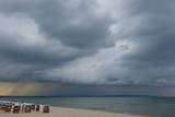 Dark Rain Clouds Drift over the Coast Photographic Print by Stefan Sauer
