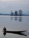 A Kashmiri Fisherman Rows His Boat Photographic Print by Farooq Khan