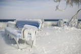 An Ice Crusted Bench Stands at the Frozen Waterside Promenade of Lake Constance in Romanshorn Photographic Print by Ennio Leanza