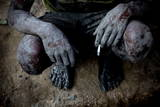 A Labourer Smokes after Finishing Digging a Well for a Water Source Photographic Print by Narendra Shrestha