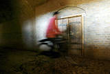 An Afghan Man Rides a Bicycle in Old Part of Herat City, Afghanistan Photographic Print by Jalil Rezayee