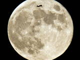 A Commercial Airliner Passing in Front of a Full Moon Photographic Print by Frank Rumpenhorst