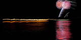 Fireworks Explode over the Hudson River Near Catskill, New York Photographic Print by Matt Campbell