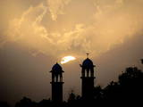 A View of a Sun Set over the Mirarettes of a Mosque in Hyderabad Photographic Print by Nadeem Khawer