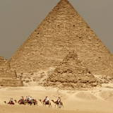 Tourists Take a Camel Ride around Mycerinus Pyramid Photographic Print by Mike Nelson