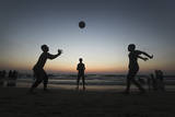 Palestinians Children Play with a Ball at Shaik Ajlen Beach in the Gaza Strip Photographic Print by Ali Ali