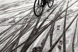 A Cyclist Crosses a Snow Covered Bridge in Munich Photographic Print by Matthias Schrader