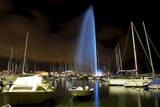 Geneva's Landmark, the Famous Water Fountain (Jet D'Eau) Is Illuminated by Blue Lights Photographic Print by Salvatore Di Nolfi