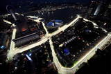 Formula One Cars Race around the Singapore Grand Prix Circuit Photographic Print by How Hwee Young