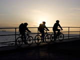 Cyclists Take a New Year's Day Ride at Dawn on the North Sea Coast at Whitley Bay Photographic Print by Lindsey Parnaby