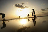 Children Play Running in the Beach at Sunset on Gaza's Beach Photographic Print by Ali Ali