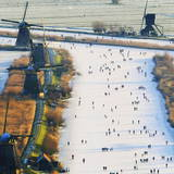 Skaters on the Frozen Canals in Kinderdijk Photographic Print by Robin Utrecht