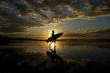 A Surfer Makes His Way to the Water to Surf at Las Flores Beach Reproduction photographique par Roberto Escobar
