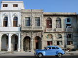 A Car Runs in the 'Malecon' of Havana Photographic Print by Alejandro Ernesto