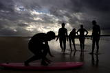 Surfers Make the Most of Bad Weather to Practise on Santa Maria Beach Photographic Print by Jorge Zapata