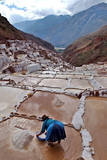 A Peruvian Woman Working at the Maras Saltern in Peru Photographic Print by Paolo Aguilar