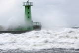 Waves Crash Against a Lighthouse Photographic Print by Adam Warzawa