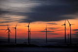 Several Wind Turbines in Front of a Red Evening Sky on a Field in Istha Near Kassel Photographic Print by Uwe Zucchi