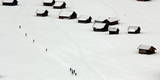 Cross-Country Skiers Glide Past a Huts in Garmisch-Partenkirchen Photographic Print by Matthias Schrader