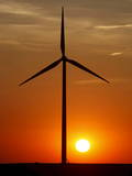 Sun Sets on a Group of Wind Turbines Photographic Print by Larry W. Smith