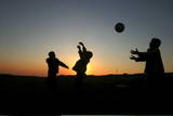 Palestinians from the Al Hawamdeh Family Play Football in the West Bank Town of Hebron Photographic Print by Abed Al Hafiz Hashlamoun