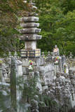 Buddhist statuettes memorialize the souls of the dead, Japan, Kyoto. Photographic Print by Dennis Flaherty