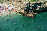 Italia, Apulia, Polignano a Mare. Crowded beach on a weekend. green. Photographic Print by Michele Molinari