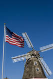 Dutch windmill and US flag, Nelis' Dutch Village, Holland, Michigan. Photographic Print by Randa Bishop