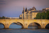 Setset over River Seine, Pont Neuf and the Concierge, Paris, France. Photographic Print by Brian Jannsen