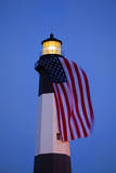 USA, Georgia, Tybee Island, Flag flying on lighthouse at Tybee Island. Photographic Print by Joanne Wells