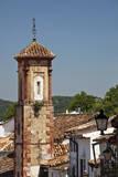 Spain, Andalucia, Grazalema. The bell tower of Iglesia de San Juan. Photographic Print by Julie Eggers