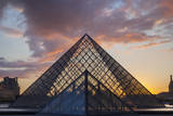 Sunset behind the glass pyramid of Musee du Louvre, Paris, France. Photographic Print by Brian Jannsen