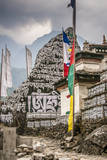 Mani Stones and prayer flags on a trail, Nepal. Photographic Print by Lee Klopfer