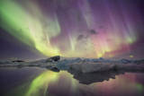 Iceland, Jokulsarlon. Aurora lights reflect in lagoon. Photographic Print by Josh Anon